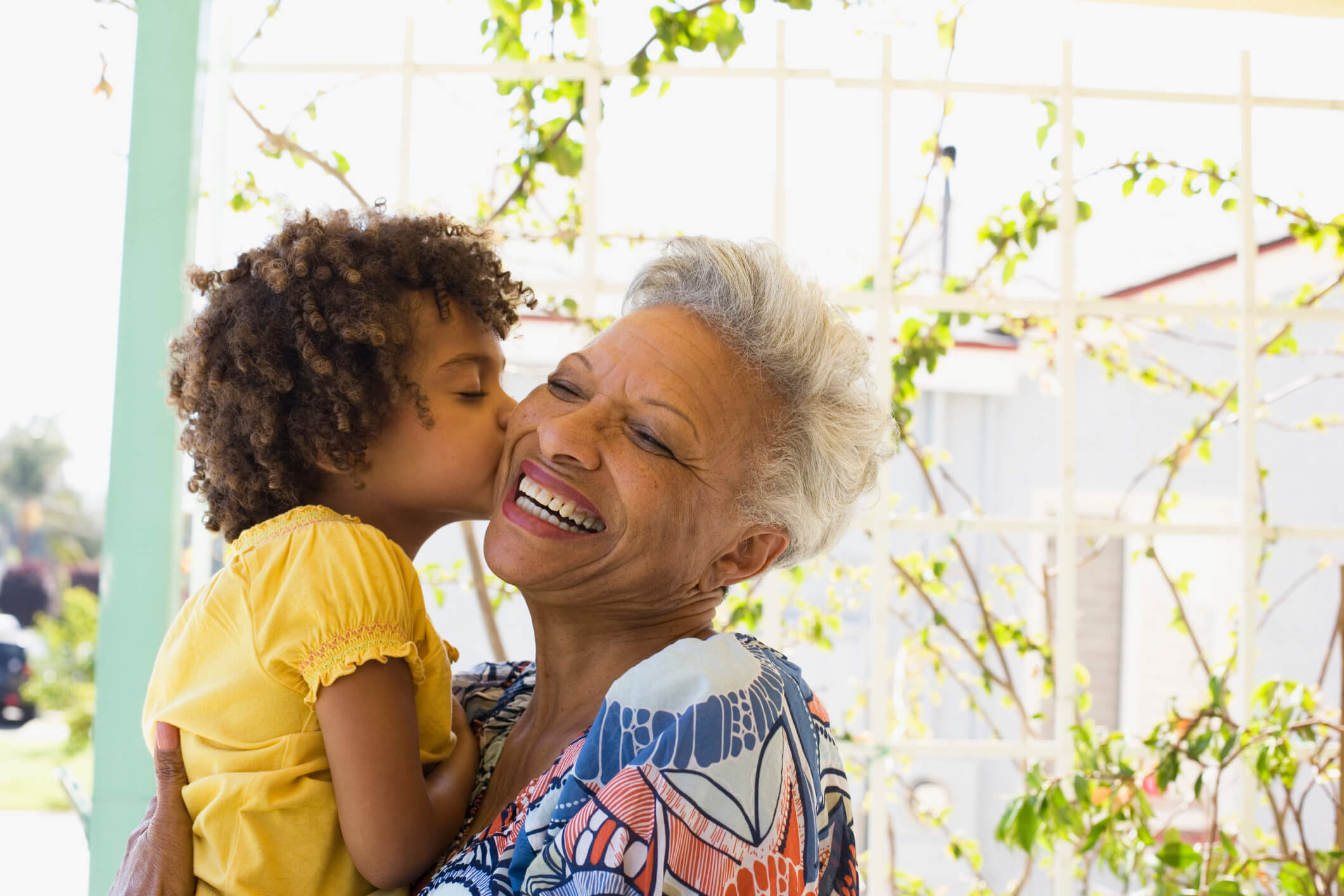 Child Kissing Grandmother on Cheek